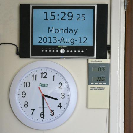 Wall mounted digital clock radio